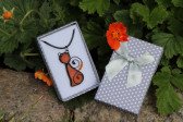 orange cat in a gift box - historical glass