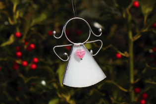 little angel with a white heart  - historical glass